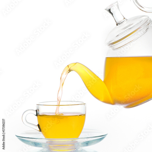 Glass teapot and  cup of tea
