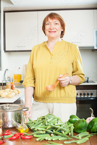 mature housewife  with fresh okra