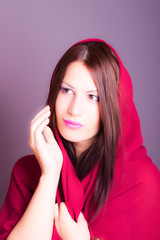 portrait of beautiful arabic woman wearing red scarf