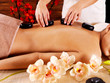 woman's body with  hot stones on back  in spa salon