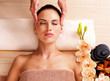 Masseur doing massage the head of an woman in spa salon