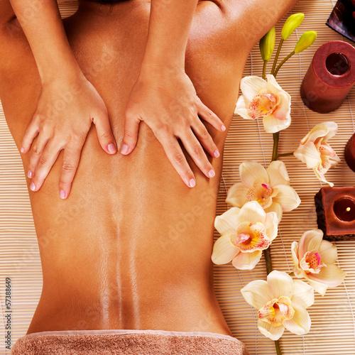 Leinwandbild Motiv Masseur doing massage on woman back in spa salon