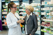 Leinwanddruck Bild - Pharmacist and grateful senior woman.