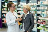 Pharmacist and grateful senior woman. - 57391697