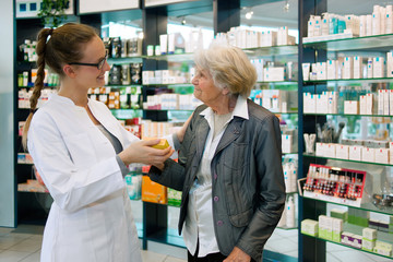 Pharmacist and grateful senior woman.