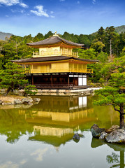 golden pavilion at Kinkakuji temple with blue sky, Kyoto, Japan