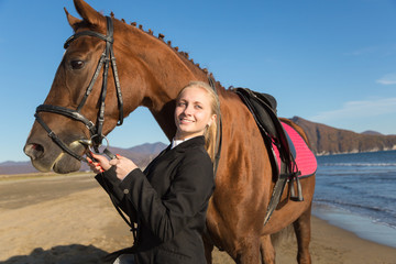 Teenage girl with a favorite horse