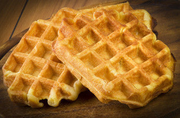 freshly baked waffles close up on the wood
