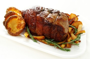 roast joint of beef with vegetables and yorkshire pudding