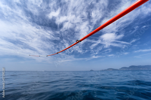 fishing rod against sea and sky
