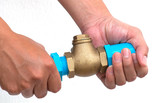 Bronze swing check valve and pvc pipe connection on hands.
