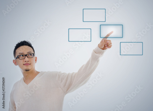 Asian man finger touching virtual transparent screen button
