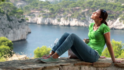 Young woman relaxing in beautiful nature scenery