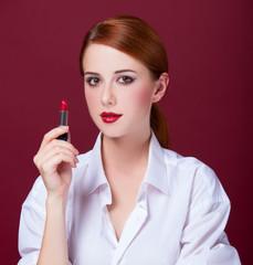 Redhead girl with lipstick