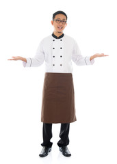 Happy Asian chef welcoming pose