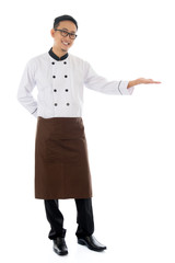 Asian male chef hand showing blank space