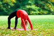 Young woman exercising yoga autumn