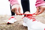 Fototapety Woman runner tying sport shoes