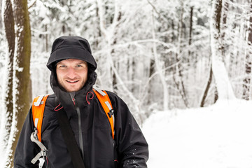 Man hiking in winter forest
