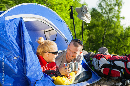Couple backpackers camping in tent
