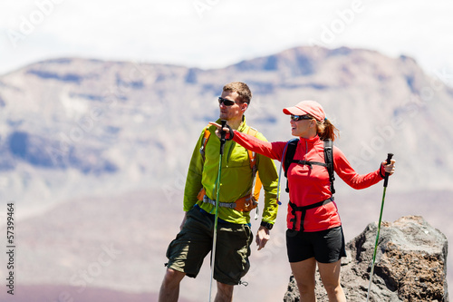 Couple hikers in high mountains