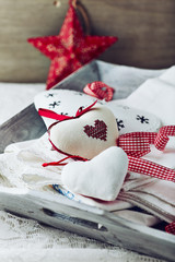 Old style christmas decorations and napkins on a wooden tray