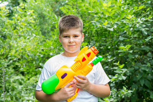 Boy with water pistol