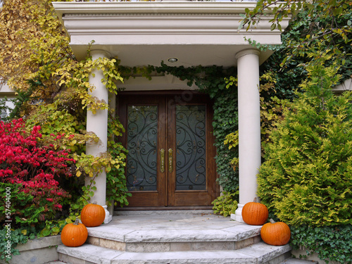 front steps with pumpkins