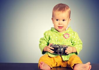 baby girl photographer with retro camera