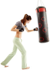 Athletic woman hitting the punching bag