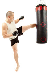 Boxer kicking the punching bag