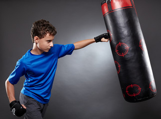 Boy hitting the punching bag