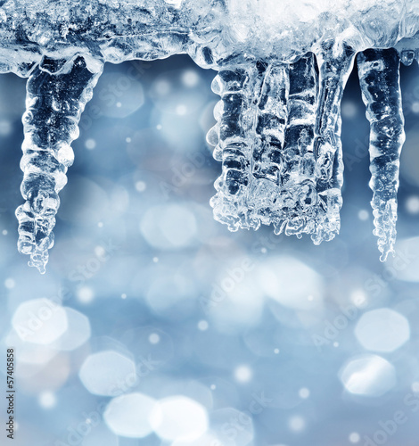 winter background with icicles and empty space