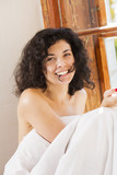 Smiling woman under blanket bite hair perm poster