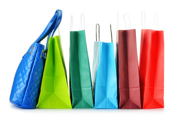 Paper shopping bags and handbag isolated on white