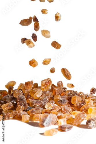 Slices of falling brown candy sugar