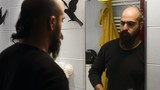 long beard and mustache man shaving in bathroom
