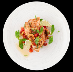 Chicken breast cooked in asian style, isolated on black