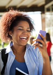 Female Student Reading Text Message On Mobilephone At Campus