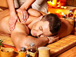 Woman getting bamboo massage.