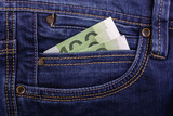 banknotes in jeans pocket