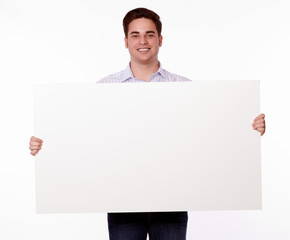 Attractive man holding up a placard