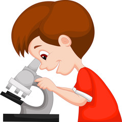 Young boy using microscope