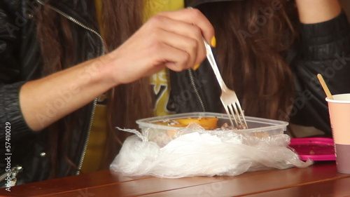 Fastfood eater, young adult woman eats fast food meal, drinks