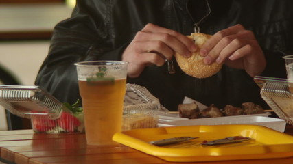 Man eating fast food restaurant meal, burgers meat beer, dining