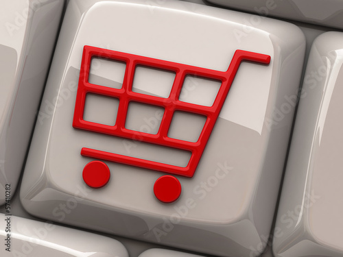 Red shopping cart symbol on computer key