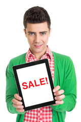 Young man holding a tablet that states sale