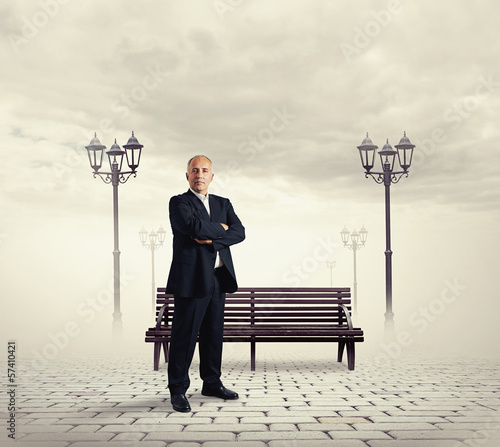 successful senior businessman standing