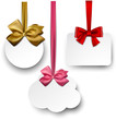 White paper gift cards with satin bows.