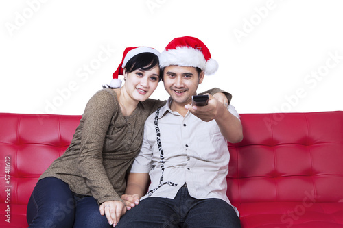 Christmas couple watching TV at home